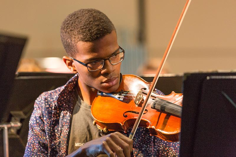 Orchestra student playing a violin