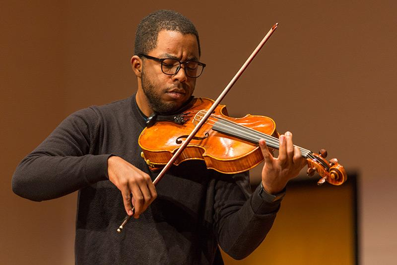A man playing the violin