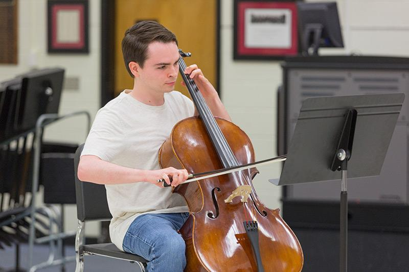 Orchestra student playing a bass