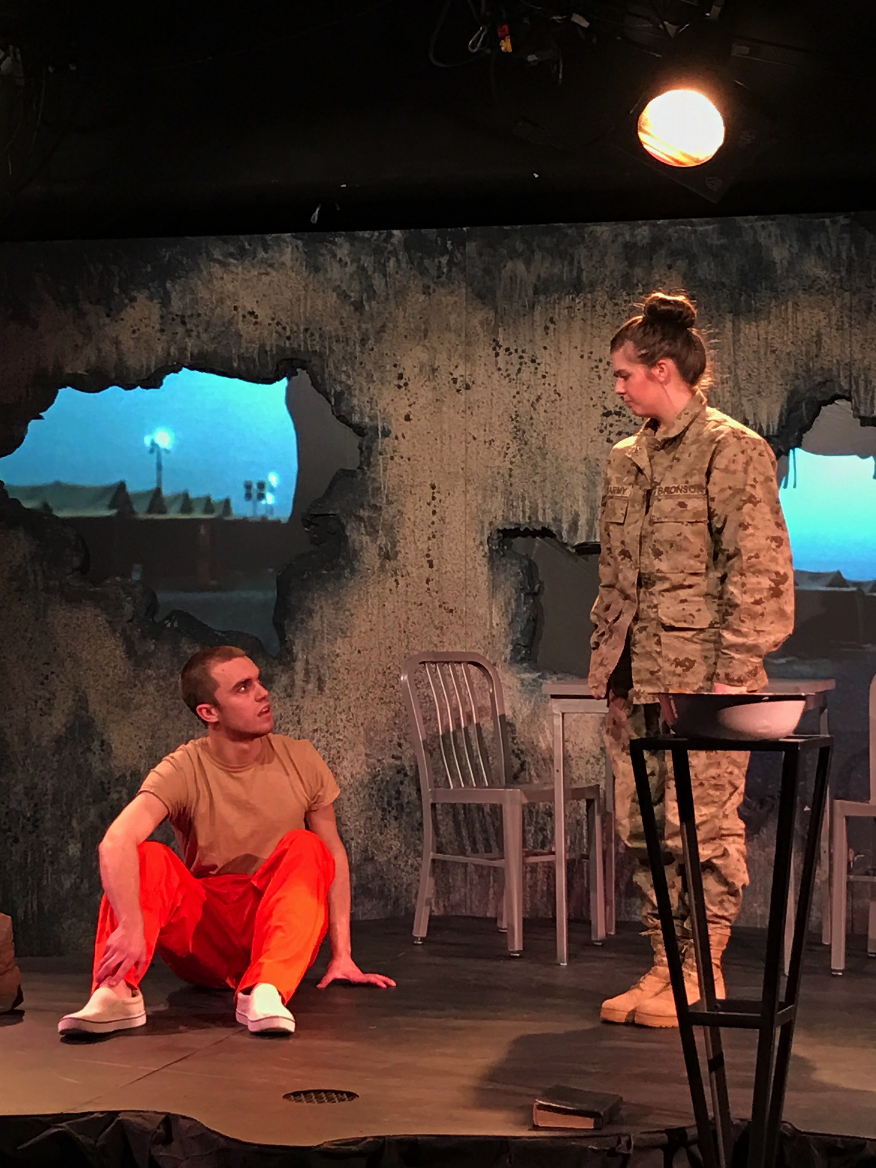 Actors in a scene from 9 Circles in the Nickerson Black Box Theatre