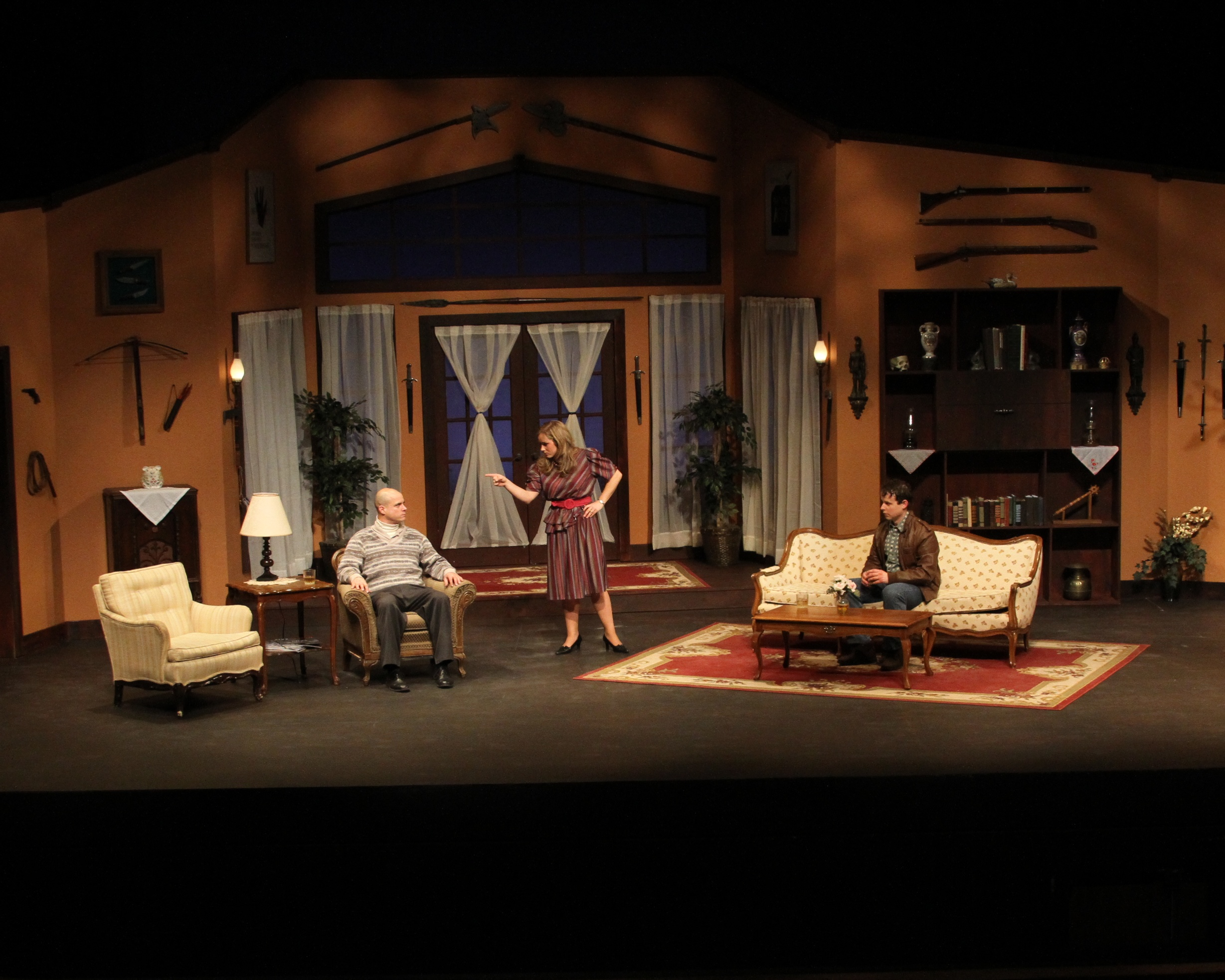 Actors on stage during a scene from Deathtrap