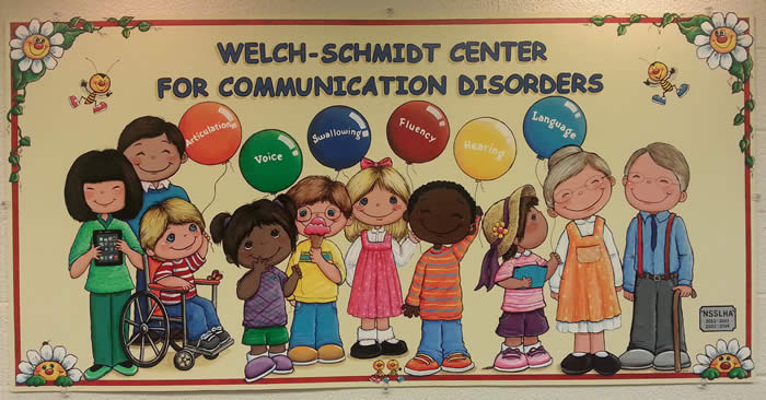 Welch-Schmidt Clinic Sign with Children