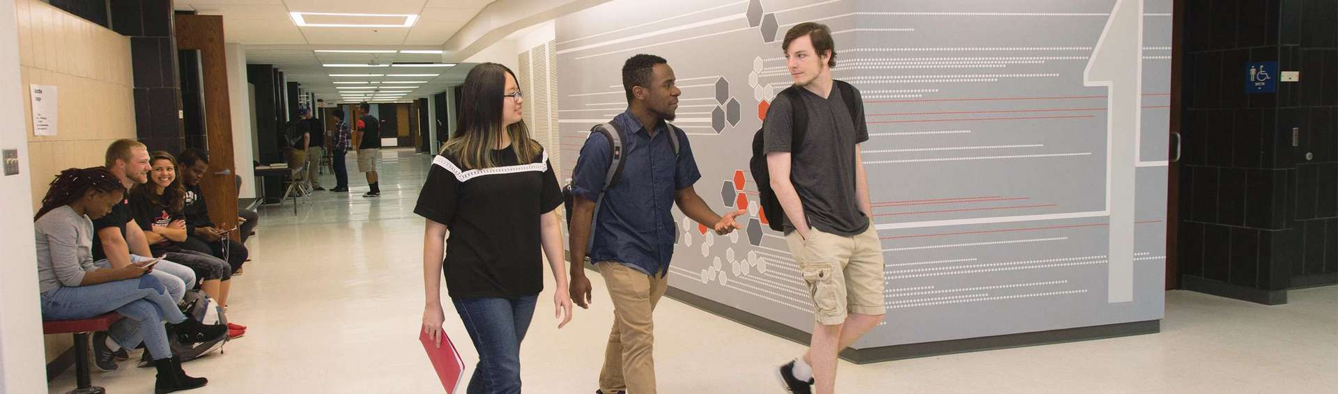 students walking in hall of W. C. Morris