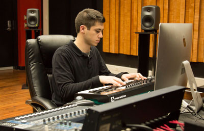 Thumbnail image: A student in a socially distanced music studio