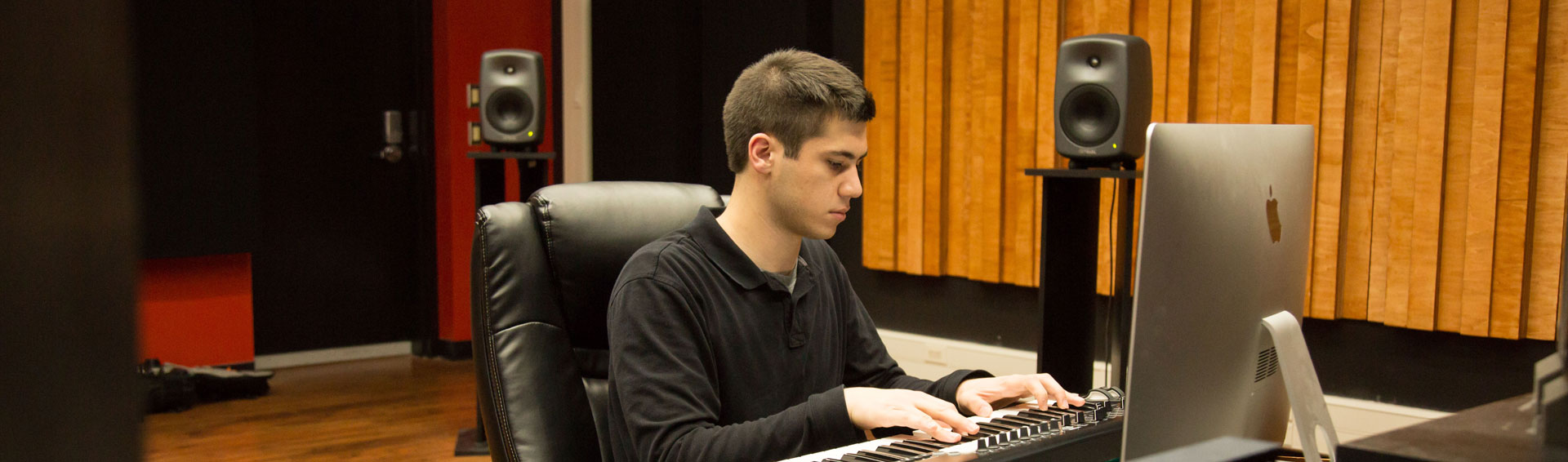 A student in a socially distanced music studio