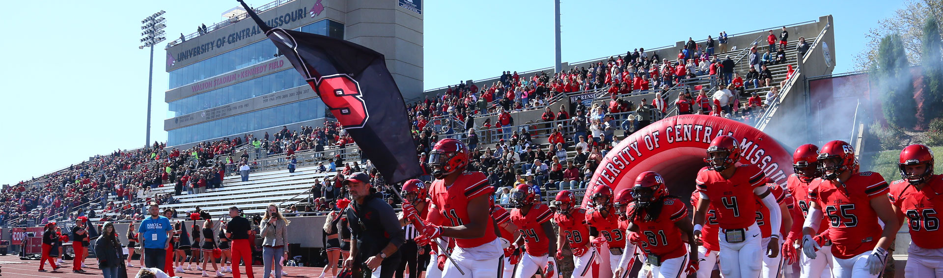 UCM football players taking the field before a game
