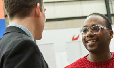 Thumbnail: UCM student meeting with a career executive at the Career Expo