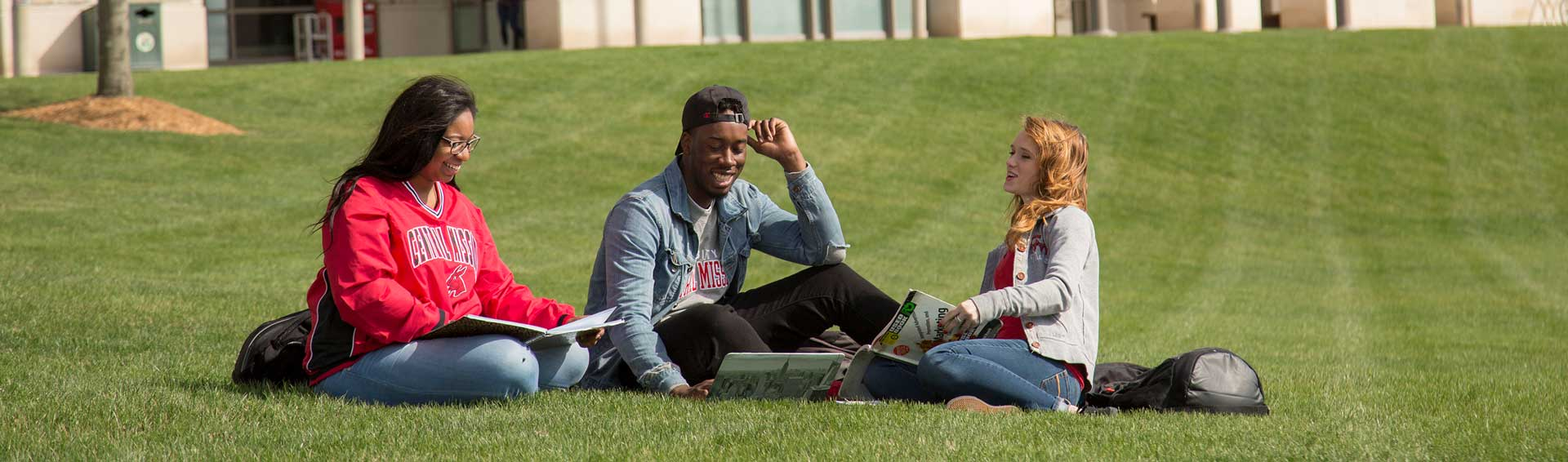UCM students studying on the JCK Library lawn