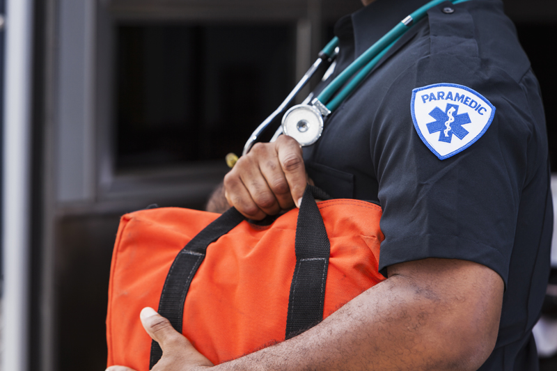 Paramedic Caring a Medical Bag