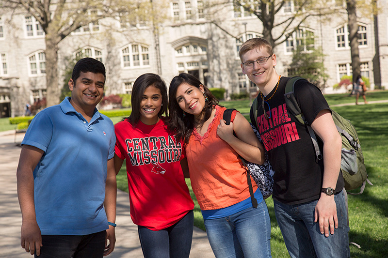 A group of students pose for a picture on campus