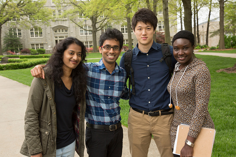 Four international students smiling at the camera