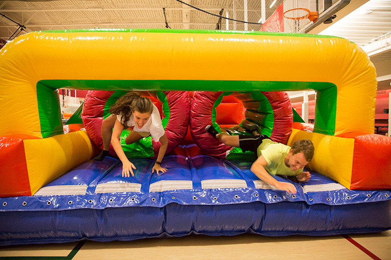 Students going through an inflatbale obstacle course