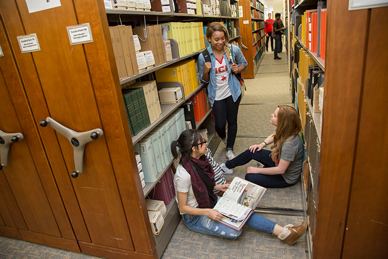 UCM students studying in library stacks
