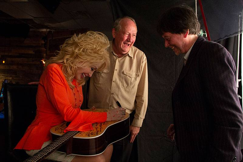 Dolly Parton Signing Guitar