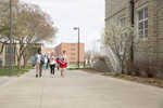 students walking outdoors on campus