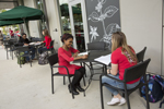 students studying outside of Starbucks