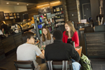 students sitting at a table at Starbucks