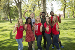"group of UCM students showing ""snouts out"" hand symbol"