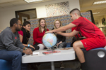group of students looking at globe